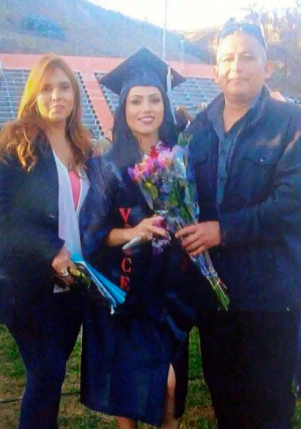 Proud parents of Jocelyn Avelica at her graduation