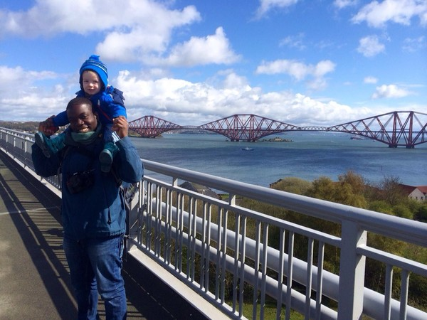 Kweku and his godson helping a friend achieve a life goal on the Forth Bridge